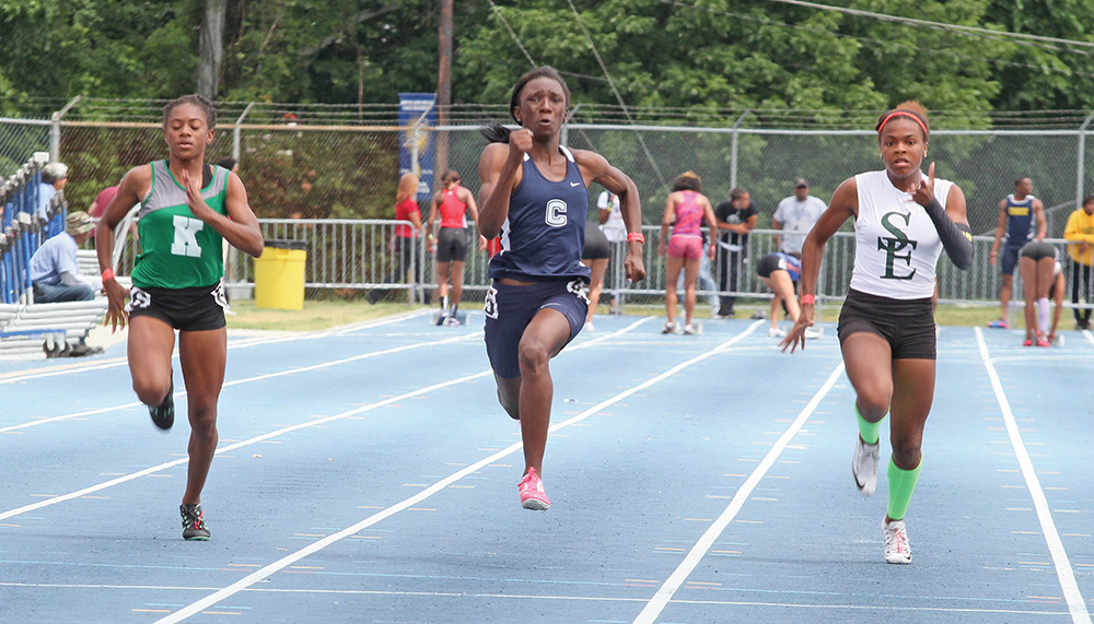 Tamara Clark (center), a High Point Central High School runner, has qualified to compete in the 100m at the New Balance Invitational in Greensboro.