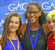 The top three medalists in the 13-14 Girls' 50-yard Backstroke: (L-R) Morgan Jones (silver medalist), gold medalist Omega Pinnix and Sarah Crump (bronze medalist).  Photo by Joe Daniels