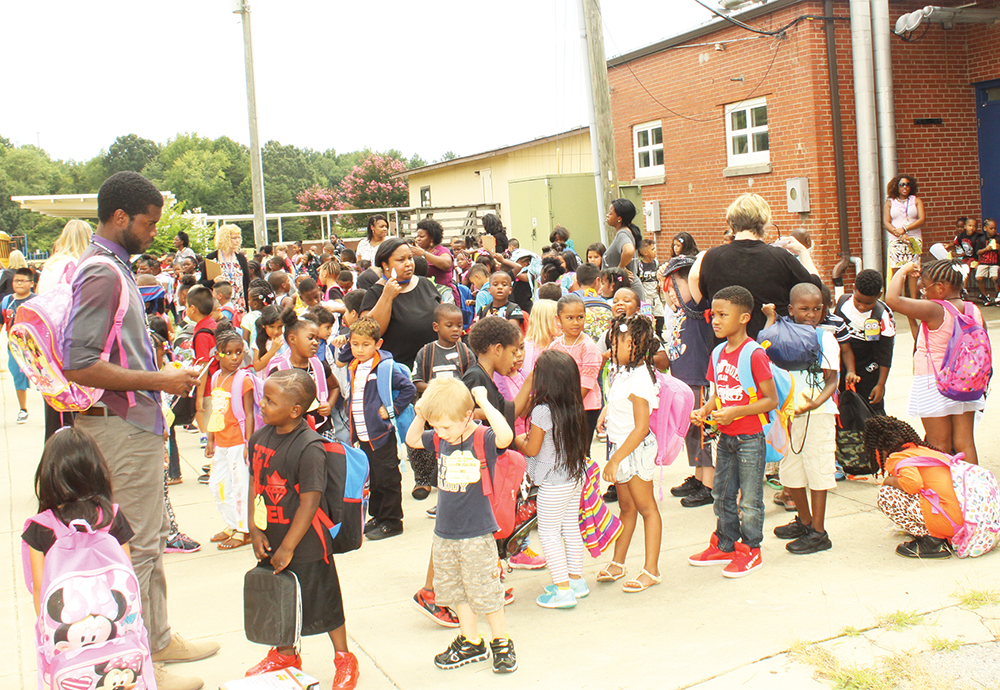 Bessemer Elementary students wait for their respective school buses after a successful first day of class on Monday, August 29. Photo by Charles Edgerton/Carolina Peacemaker
