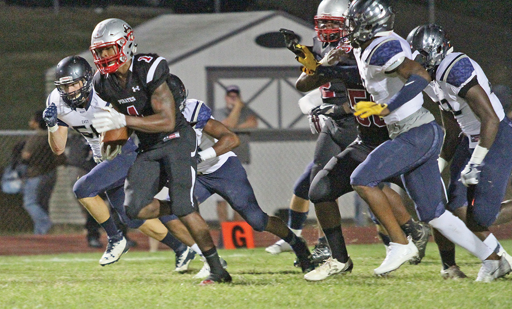Page senior running back Javon Leake rushed for 214 yards including touchdown runs of 92 and 67 yards. Photo by Joe Daniels/Carolina Peacemaker