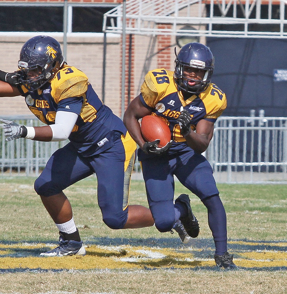 Aggie Tarik Cohen (right) is poised to break the MEAC rushing record with just 630 yards this season. Joe Daniels/Carolina Peacemaker