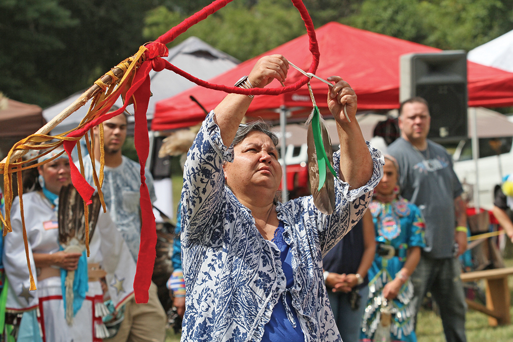 Senora Lynch of the Haliwa-Saponi Tribe prepares an Eagle Staff in honor of the late Mrs. Ruth Locklear Revels, the first executive director of the Guilford Native American Association, who served for 22 years. Photo by Joe Daniels/Carolina Peacemaker