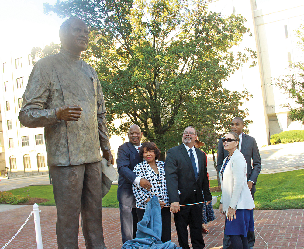 The unveiling of the George Simkins statue: Steve Bowden, Simkins PAC chairman, Shirley Frye and members of the Simkins family: Chris Simkins, Jeanne Simkins Hollis and  Andrew Simkins Hollis. Photo by Charles Watkins/Carolina Peacemaker