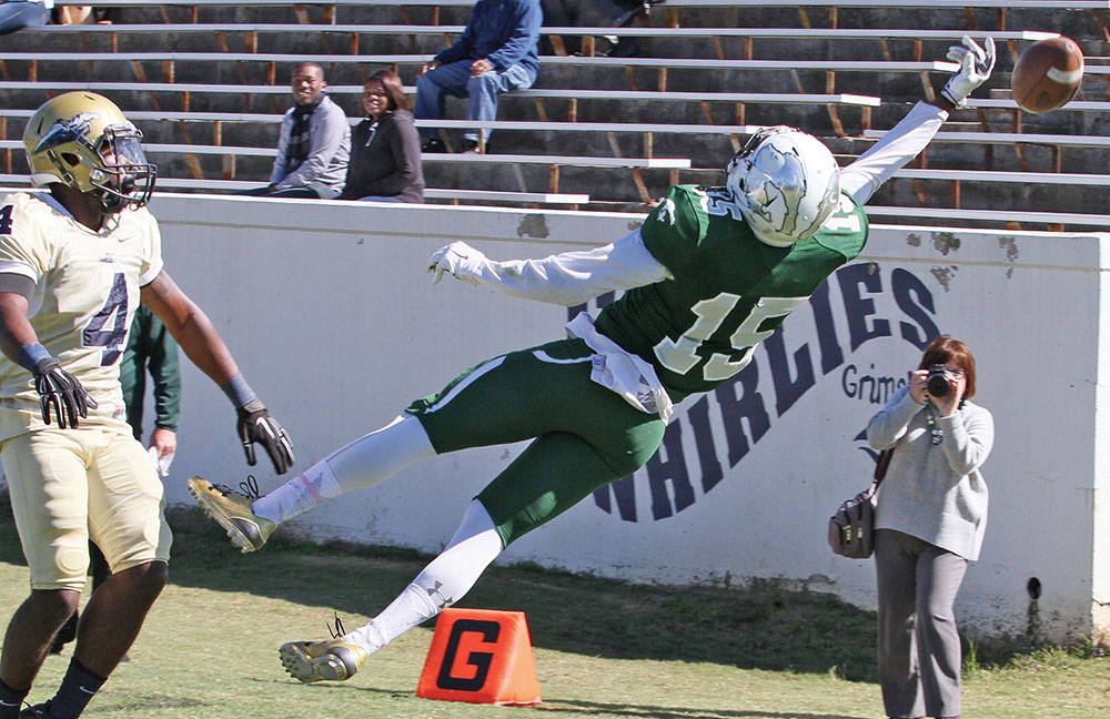 Senior wide receiver Tavares Thomas' leaping attempt for a pass reception for The Pride from quarterback Mac Graham was just off his fingertips. Photo by Joe Daniels/ Carolina Peacemaker