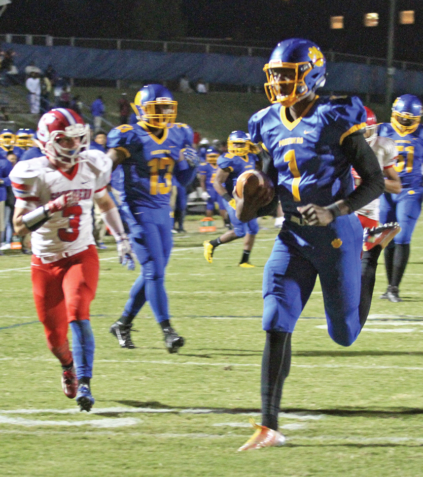 Hendon Hooker, Dudley senior quarterback, had an outstanding night finishing with 14-of-18 passing for 266 yards and three touchdowns. Hooker also rushed for two more scores on seven attempts totaling 84 yards. Photo by Joe Daniels