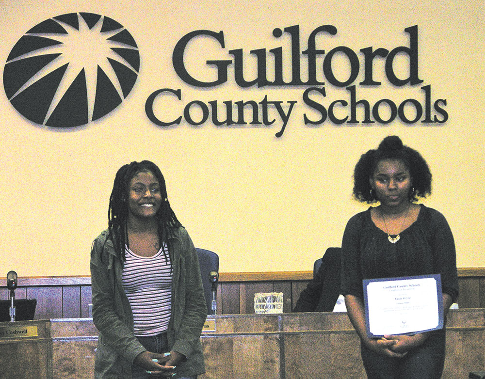 Ayatana Osinowo (left), a student at Southern High School, was the first place high school poster winner and Kayla Kizzie (right), a student at Southeast Guilford Middle, was the first place middle school poster winner. Photo courtesy GCS