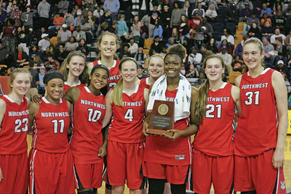 The Northwest Guilford Vikings pose with the Western Regional Girls 4-A Championship trophy. They will play Southeast Raleigh for the State 4-A Championship on Saturday, March 11, at NCSU's Reynolds Coliseum. Photo by Joe Daniels/Carolina Peacemaker