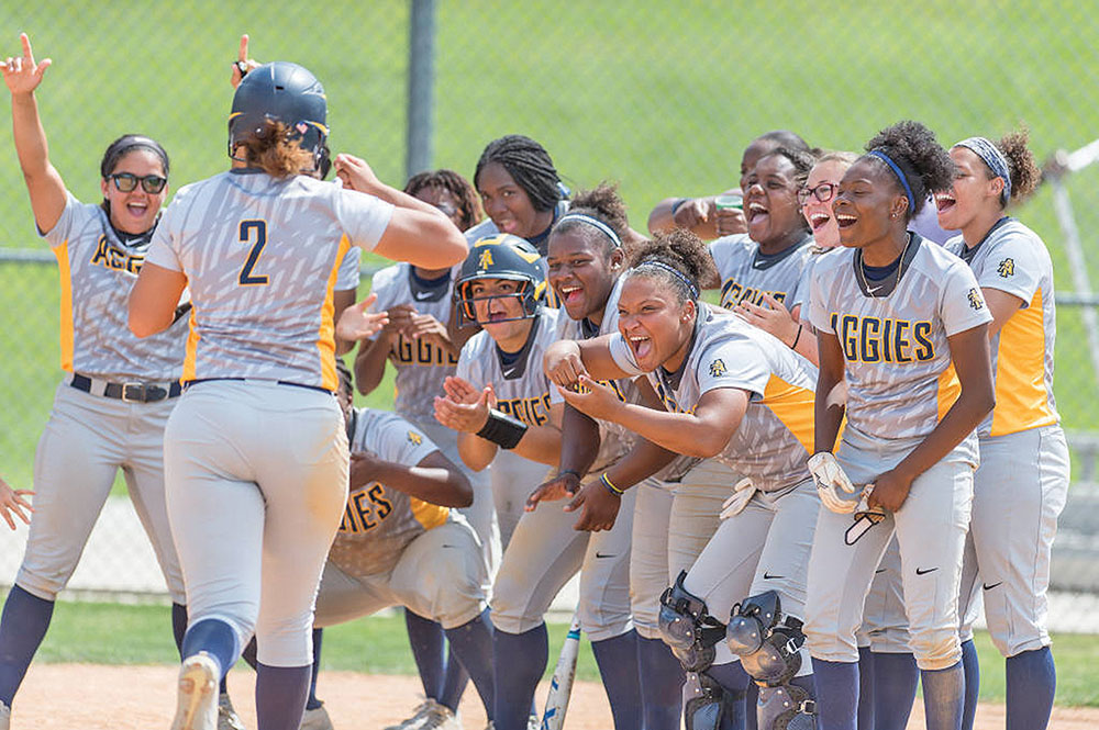 Aggies sophomore Mohagony Headen is greeted by teammates after hitting a home run. Headen hit two HRs, posted five RBI's and scored three times in game two. Photos courtesy Kevion Dorsey