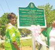 International President of Alpha Kappa Alpha Sorority, Inc., Dorothy Buckhanan Wilson, and Mid-Atlantic Regional Director, Joyce Henderson, unveil a historical maker commemorating the life and accomplishments of founding member, the late Margaret Flagg Holmes. Photo by Charles Edgerton/Carolina Peacemaker