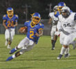 Dudley High School quarterback Gerald Simpson (#2) rushed for 79 yards on 16 carries and completed 10-of-14 passes for 115 yards and a touchdown against Durham Hillside on Friday, Sept. 8 at Tarpley Stadium. Photo courtesy of Joe Daniels/Carolina Peacemaker