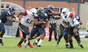 A&T junior running back Marquell Cartwright  added 96 yards rushing and two touchdowns on 19 carries for the Aggies against the Delaware State Hornets. Joe Daniels/Carolina Peacemaker