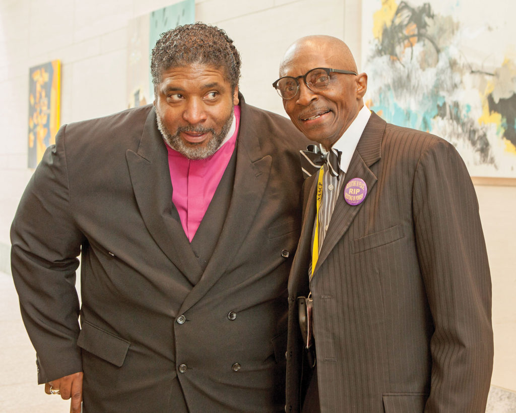Bishop William J. Barber II, president emeritus of the N.C. NAACP, has passed the baton to Rev. Dr. T. Anthony Spearman of Greensboro, the newly elected president of the N.C. Conference of Branches of the NAACP. Photo by  Ivan Cutler/Carolina Peacemaker.