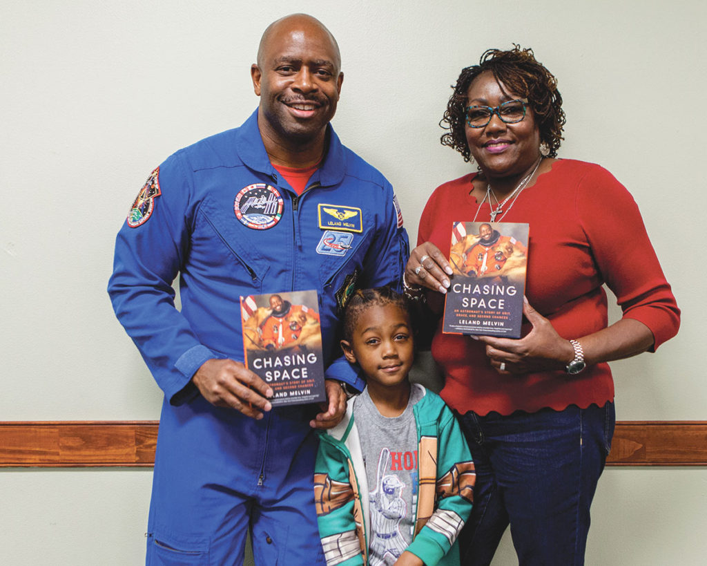 Author and former NASA astronaut, Leland Melvin (left), stands with Santana Hayes, grandson of Barbara Harris, assistant city manager, City of Greensboro. Photo courtesy of Ivan Cutler.