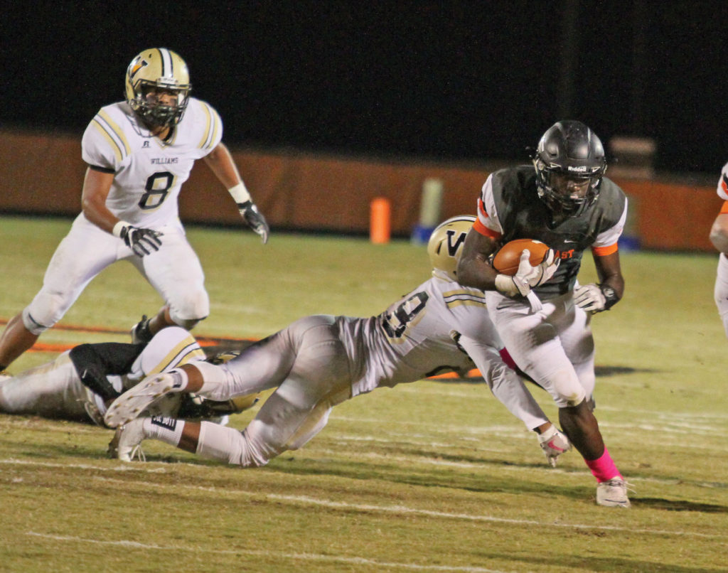 Keshawn Baldwin, a senior running back for the Falcons, finished with five carries for 25-yards and a 15-yard touchdown run Photo by Joe Daniels / Carolina Peacemaker