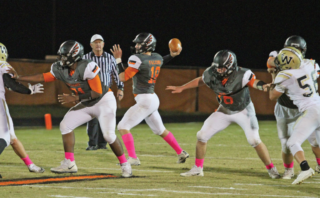 Ryan Douglas, a junior quarterback, led the Falcons with 11-of-13 passes for 165-yards and three touchdowns in a 42-14 victory over Burlington-Williams. Photo by Joe Daniels