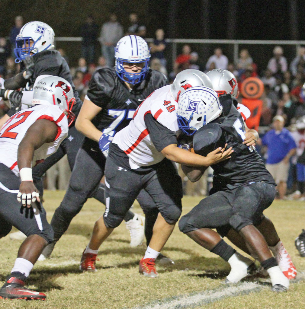 Kam Gavin, a Page junior linebacker, tackles Ragsdale's Malachi Maness for a loss during first quarter play. Photo by Joe Daniels/Carolina Peacemaker.