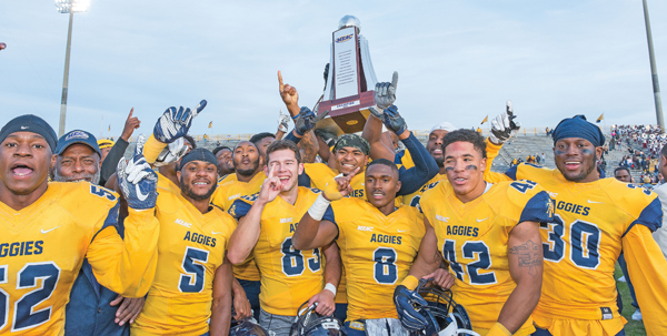 Members of the N.C. A&T State University football team hoist the MEAC Championship trophy in the air after defeating the Eagles of N.C. Central, 24-10. Photo Courtesy Kevin L. Dorsey