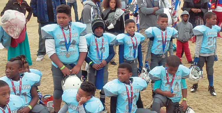 Players on the Carolina Cowboys 8-U team received their runner-up medallions after falling to the N.C. Giants in the AAU State Championship game on December 2. Photo by Semaj Marsh/Carolina Peacemaker