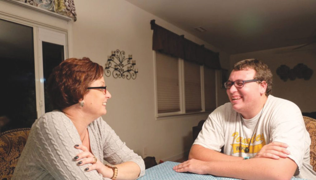 Kristine and Shawn Stead share a laugh at their home in Garner. Photo courtesy Taylor Knopf.