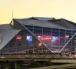 A general view of the exterior of Mercedes-Benz Stadium, as the sun sets, Thursday, August 24, 2017 in Atlanta. Mercedes-Benz stadium opens on Saturday, August 26, 2017 and will be the new home of the Atlanta Falcons and the Atlanta United FC. (Paul Abell via AP)