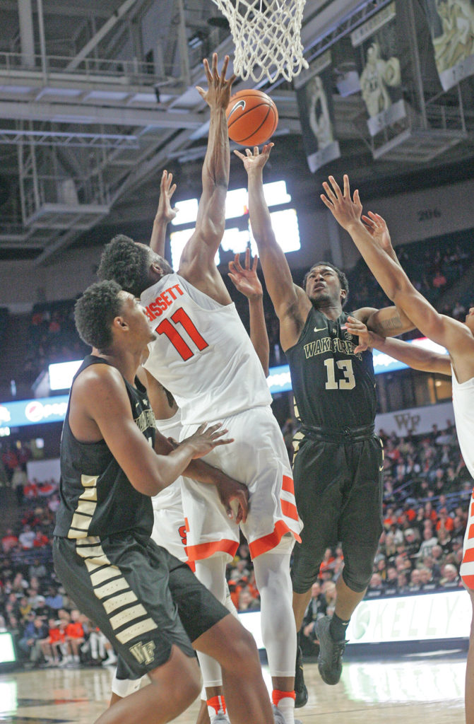 Junior guard Bryant Crawford (#13) scored a team-high 19 points, hauled down five rebounds and had five assists in Wake Forest's ACC win over Syracuse. Photo by  Joe Daniels/Carolina Peacemaker